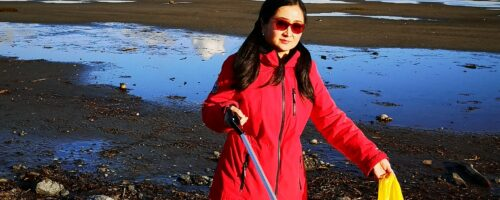 Zhao family cleanup shoreline close to Delta Heritage Airpark